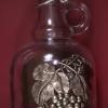 Törkölypálinkás csatos üveg óndíszítéssel